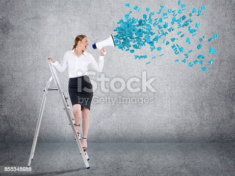 istock Businesswoman screaming into megaphone 855348688