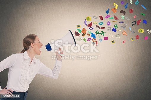 istock Businesswoman screaming into megaphone 855348744
