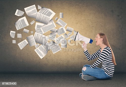 903659714istockphoto Businesswoman screaming on megaphone 875625430