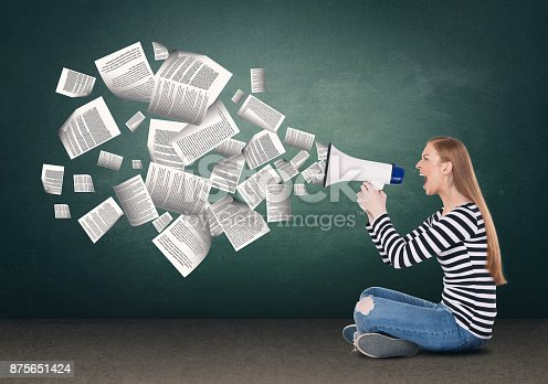 903659714istockphoto Businesswoman screaming on megaphone 875651424
