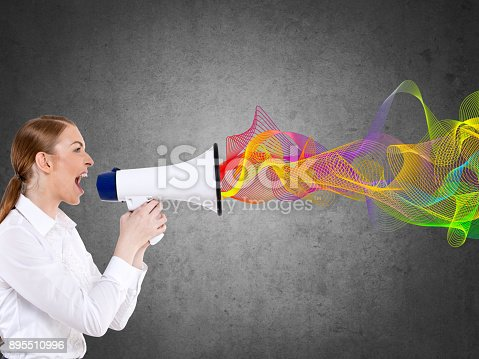 904250492istockphoto Businesswoman screaming on megaphone 895510996