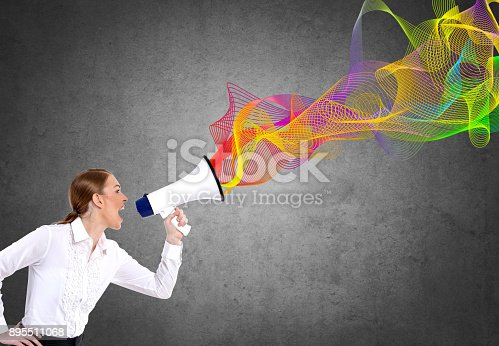 istock Businesswoman screaming on megaphone 895511068