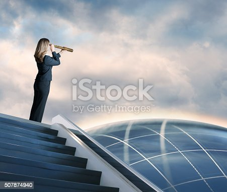 A businesswoman at the top of a staircase peering through a spyglass at a globe in the distance. Standing atop a futuristic staircase, she scopes out the future contemplating innovation.  A soft halo of light emanates off the wistful globe, with a grid pattern traversing the atmosphere.