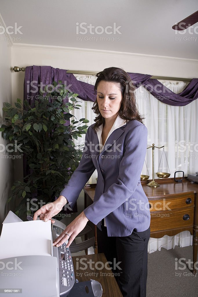 Businesswoman Sending a Fax royalty-free stock photo