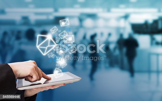 545576042 istock photo Businesswoman sending email by digital tablet in skytrain statio 545569446