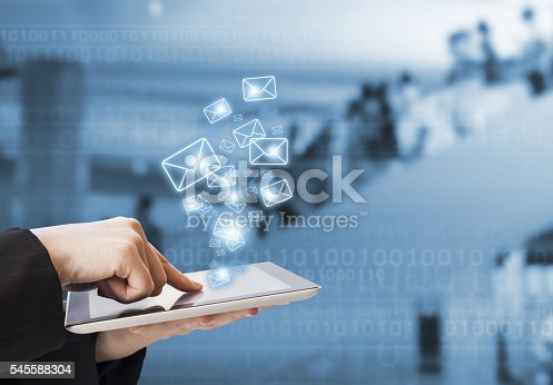 545576042 istock photo Businesswoman sending email in the shopping mall 545588304