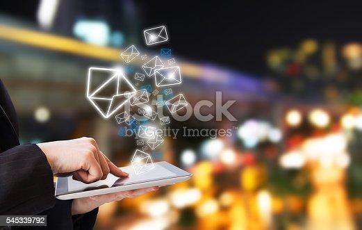 545576042 istock photo Businesswoman sending email marketing 545339792