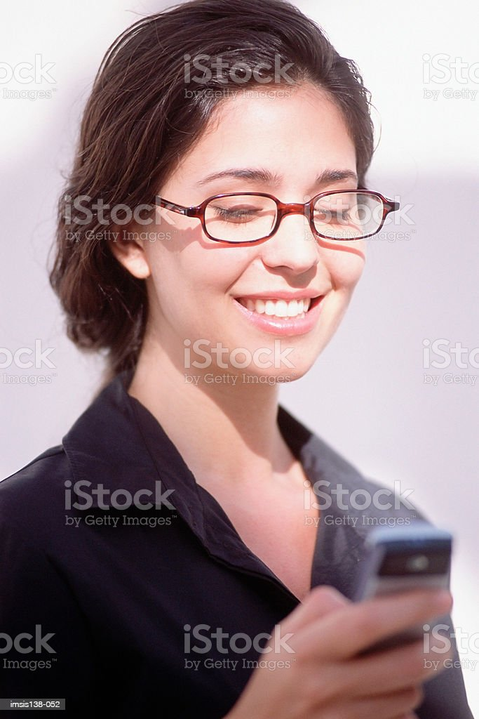 Businesswoman sending text royalty-free stock photo