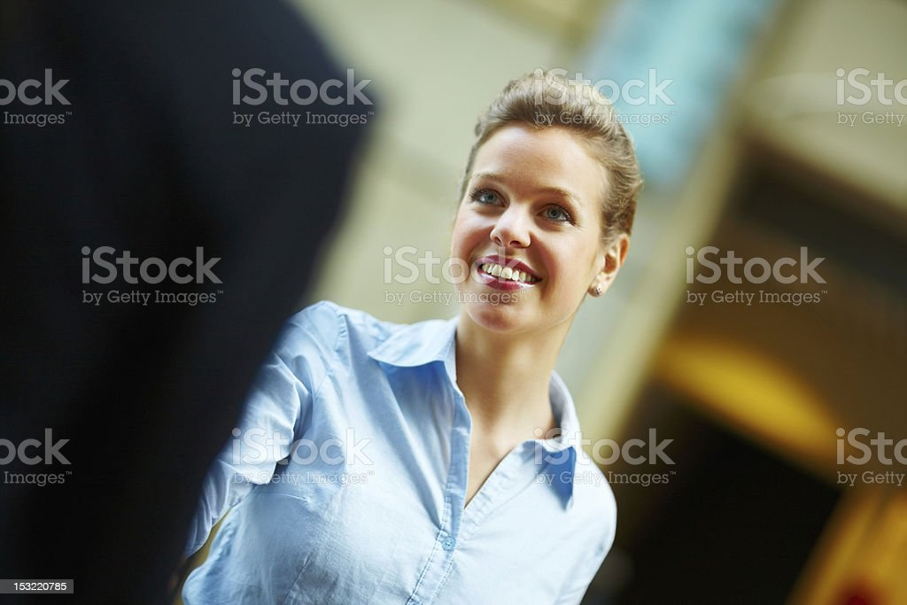 Businesswoman shaking hands and smiling royalty-free stock photo