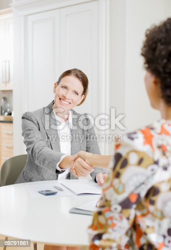 istock Businesswoman shaking hands with woman 89291861