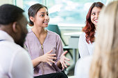 istock Businesswoman shares ideas during meeting 868584270