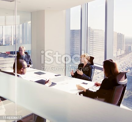 istock Businesswoman sharing ideas in conference room meeting 1149306412