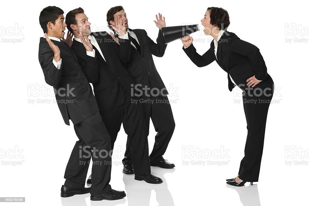 Businesswoman shouting at her colleagues royalty-free stock photo