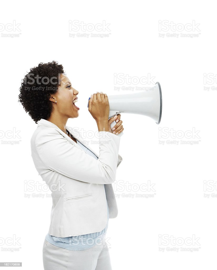 Businesswoman shouting on megaphone stock photo