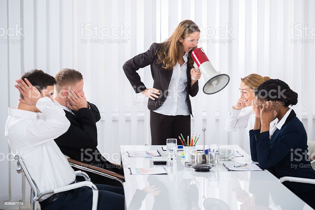 Businesswoman Shouting Through Megaphone stock photo