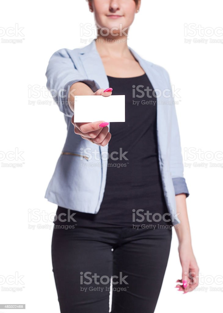 Businesswoman showing a blank business card. White background. stock photo