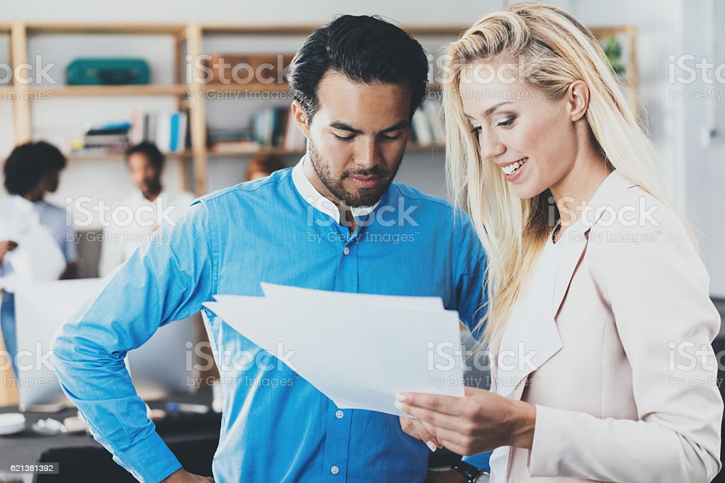 Businesswoman showing a finance report to the colleague. Two coworkers stock photo
