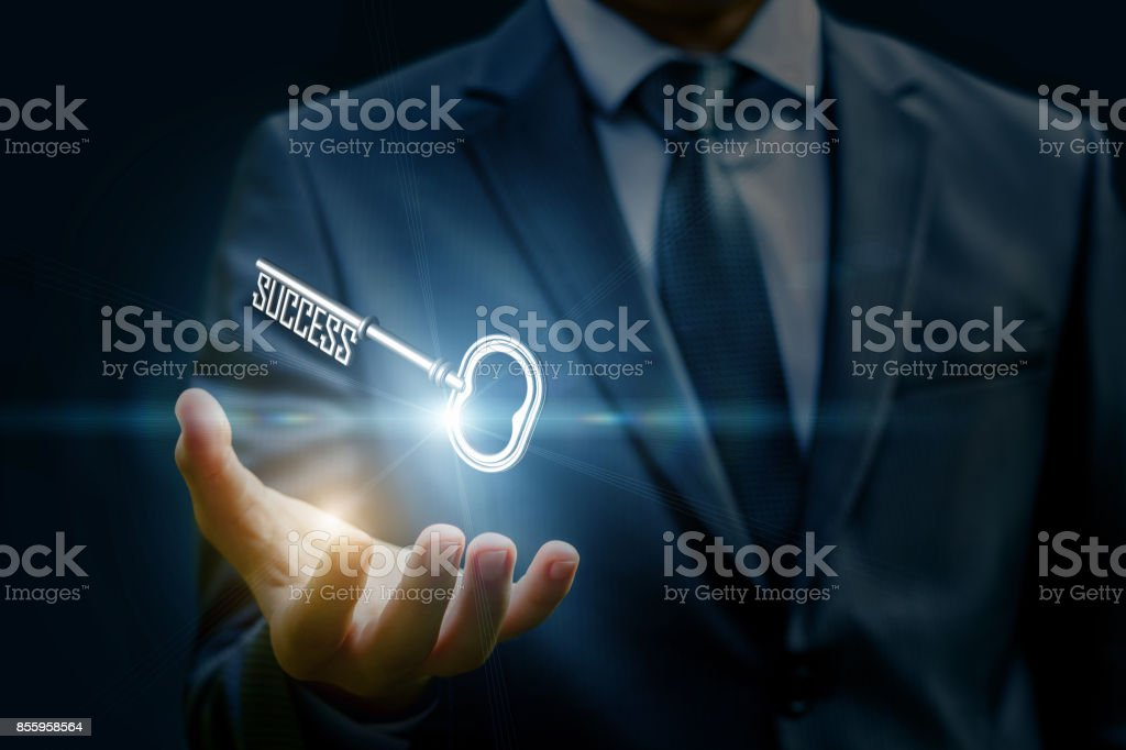 Businesswoman showing a key in his hand. stock photo