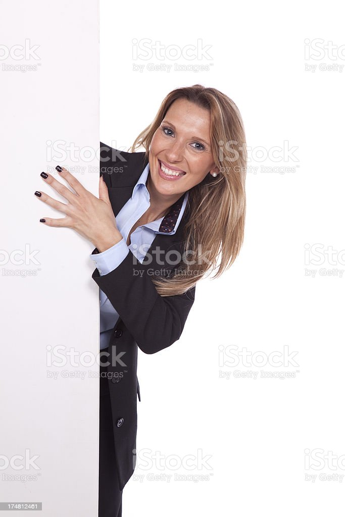 Businesswoman showing blank signboard royalty-free stock photo