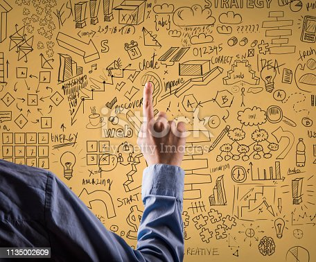 istock Businesswoman showing charts and diagrams / Yellow background concept (Click for more) 1135002609