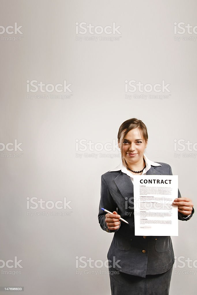 Businesswoman showing contract royalty-free stock photo