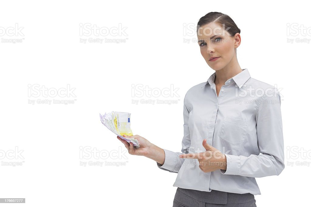 Businesswoman showing money in her hand royalty-free stock photo