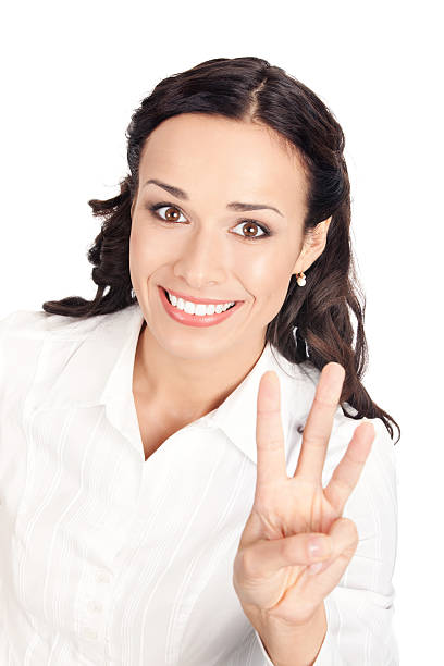 Businesswoman showing three fingers, on white stock photo