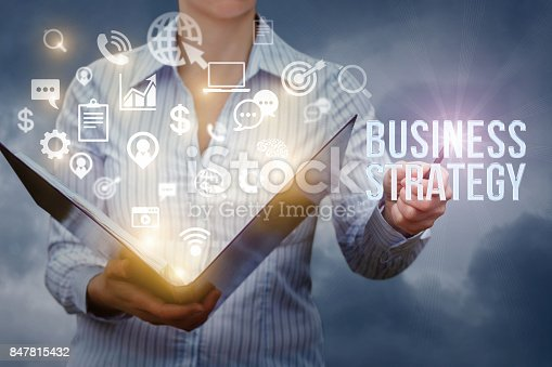 istock Businesswoman shows in the writing business strategy . 847815432
