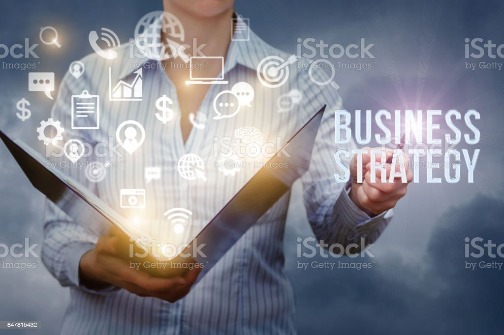 Businesswoman shows in the writing business strategy . stock photo