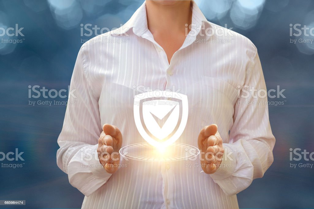 A businesswoman shows installed protection . stock photo