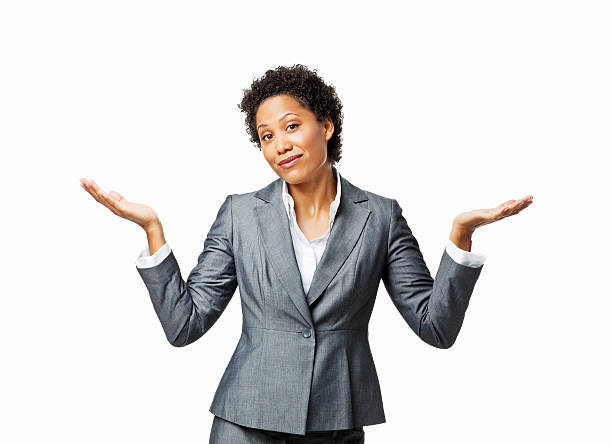 Businesswoman Shrugging Her Shoulders - Isolated Businesswoman shrugs her shoulders while looking at the camera. Horizontal shot. Isolated on white. shrugging stock pictures, royalty-free photos & images