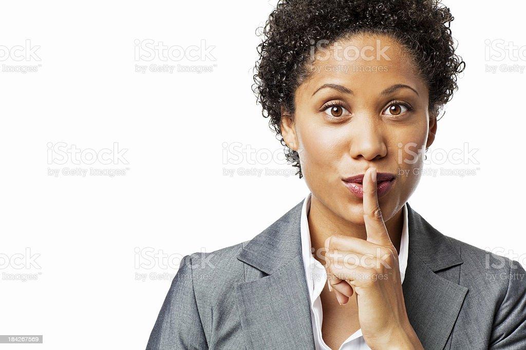 Businesswoman Shushing the Camera stock photo