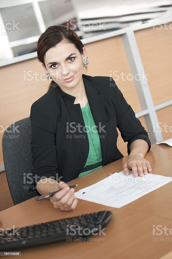 Businesswoman signing contract royalty-free stock photo