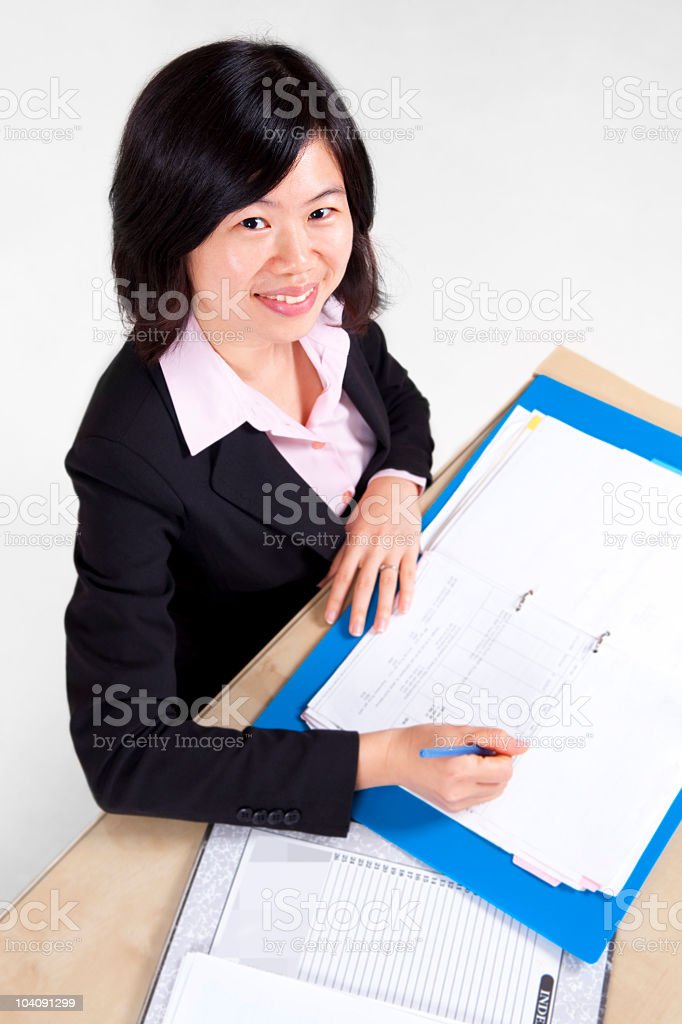 Businesswoman signing document royalty-free stock photo