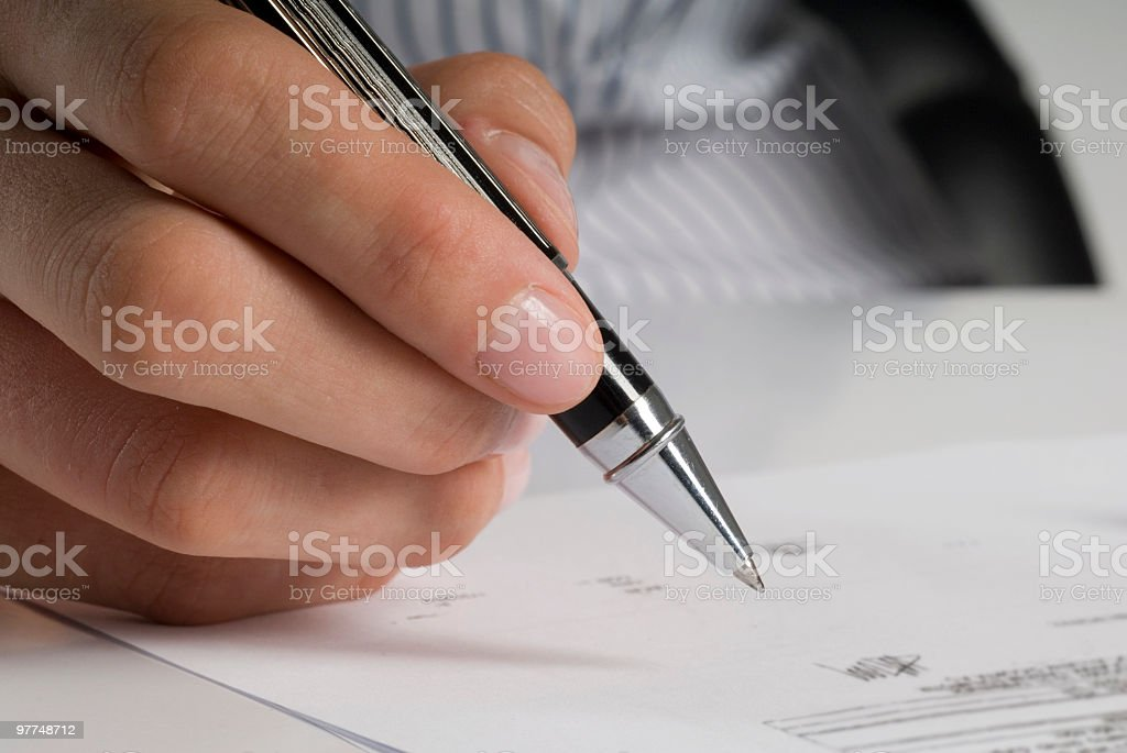 Businesswoman signing documents, Close-up of hands royalty-free stock photo