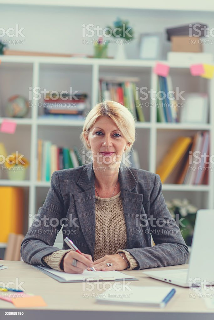 Businesswoman signing financial documents for taxation stock photo