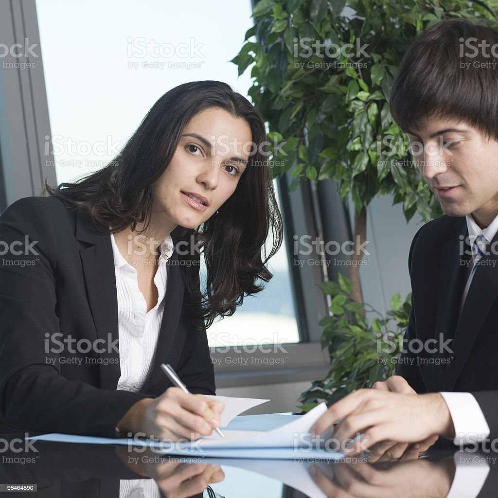 businesswoman signing papers royalty-free stock photo