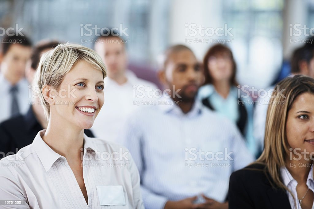 Businesswoman sitting at a seminar royalty-free stock photo