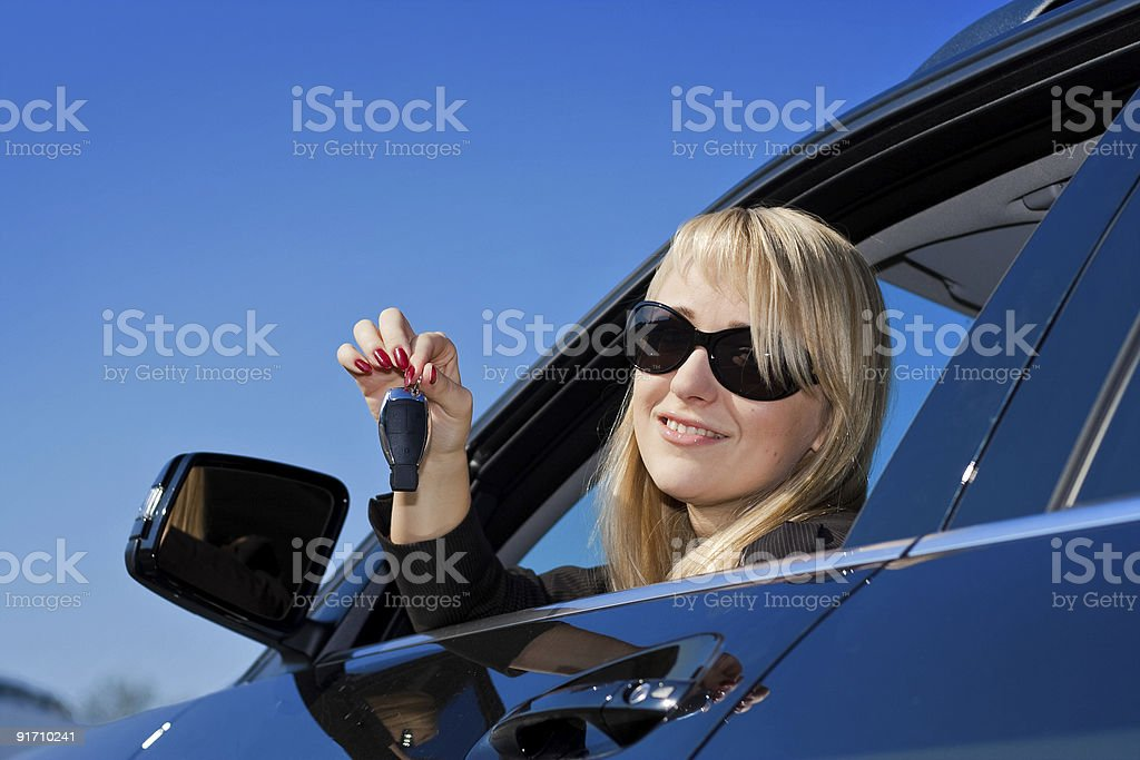 Businesswoman sitting in a car royalty-free stock photo