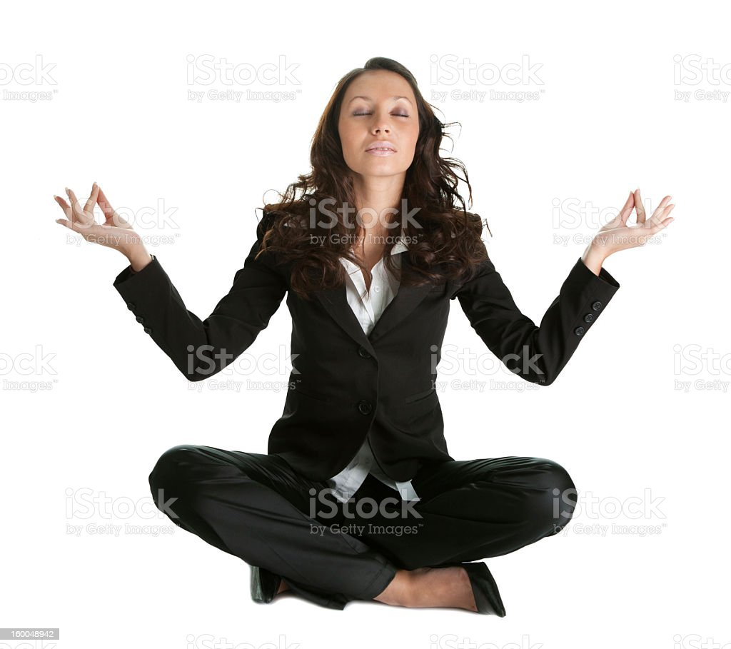 Businesswoman sitting in lotus flower position royalty-free stock photo
