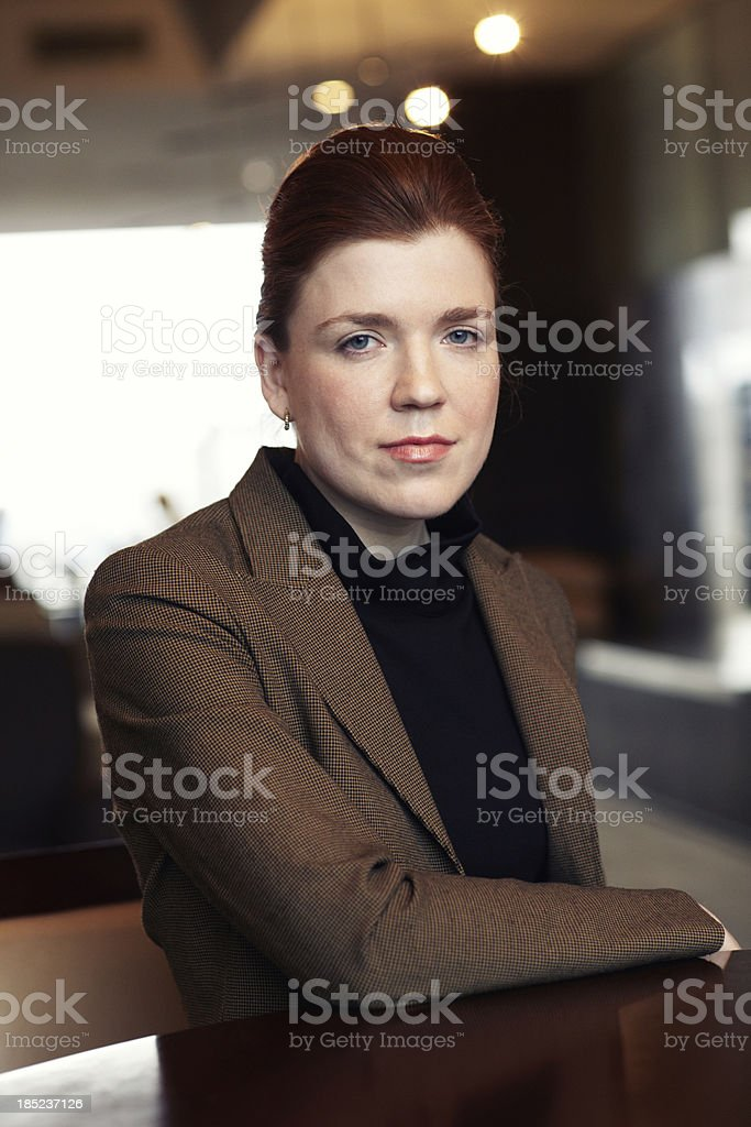 Businesswoman sitting in the office stock photo