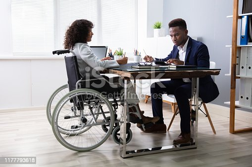 1144373653 istock photo Businesswoman Sitting In Wheelchair 1177793618