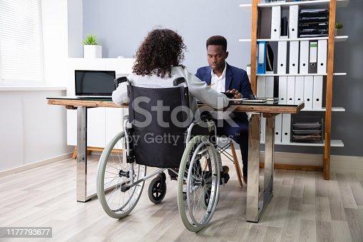 1144373653 istock photo Businesswoman Sitting In Wheelchair 1177793677