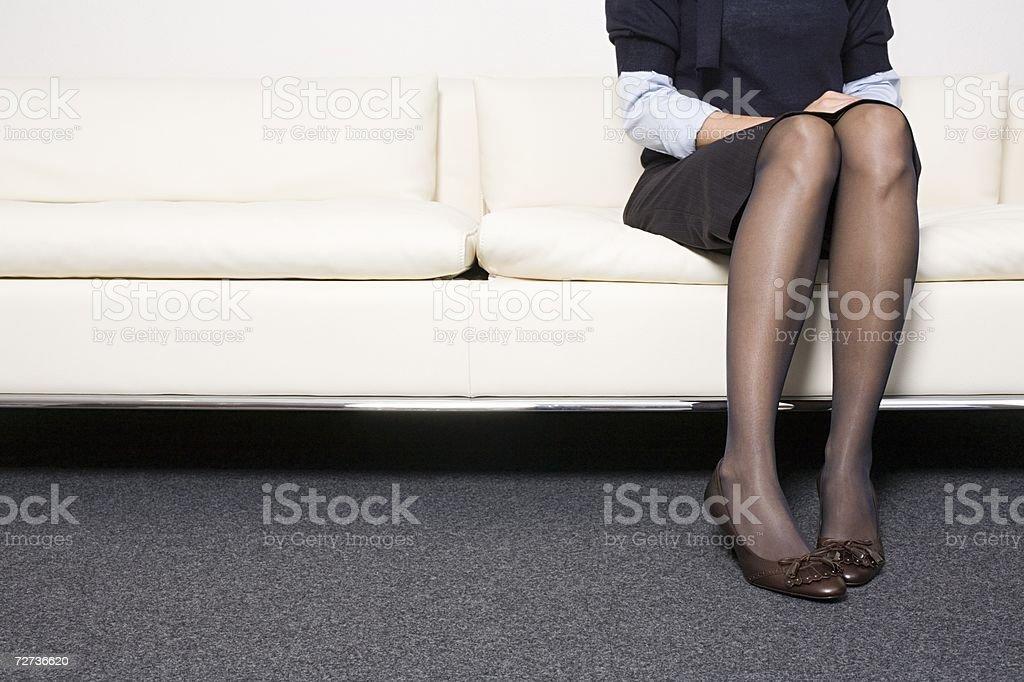 Businesswoman sitting on a sofa royalty-free stock photo
