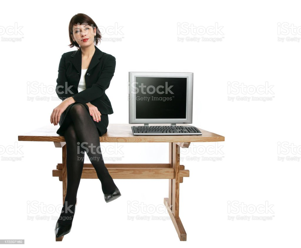 businesswoman sitting on a table royalty-free stock photo