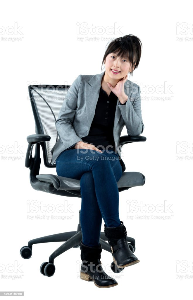 Businesswoman sitting on office chair stock photo