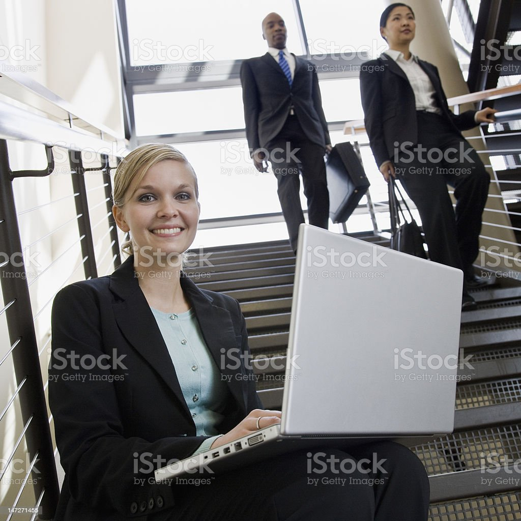 Businesswoman Sitting on Stairs With Laptop royalty-free stock photo