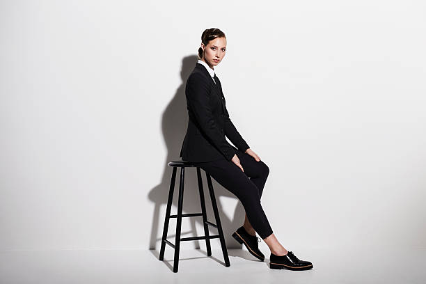 Businesswoman sitting on stool portrait picture id536678752?b=1&k=6&m=536678752&s=612x612&w=0&h=mxoqdmz7xirulw1y9yu3hg49fje4hye0 di0gzq i y=