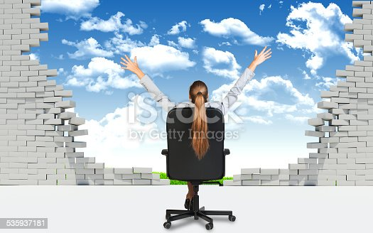 istock Businesswoman sitting on the office chair in front of broken 535937181