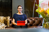 Businesswoman sitting with digital tablet on sofa